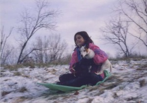 Claire at eleven, sledding with her puppy Jack (January 1998)
